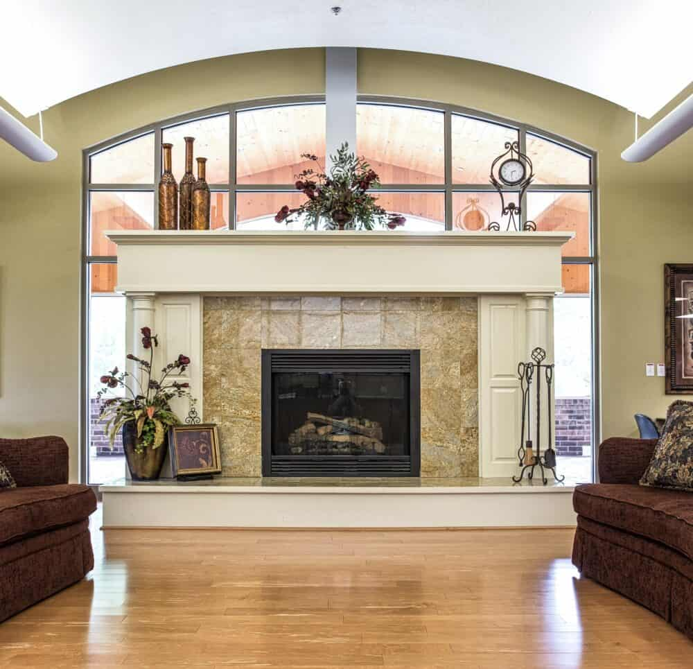 Interior room with a fireplace and ample seating.