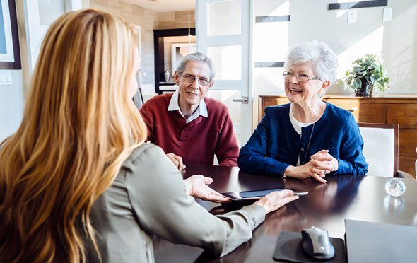 Senior smiling during a meeting with a trusted advisor.