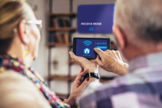 Two seniors learn how to use their smart home devices.