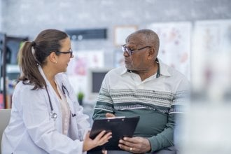 Doctor discussing medical issues with senior patient