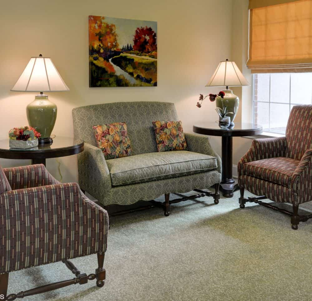 Cozy seating area with couches at senior living community in Plano, Texas.