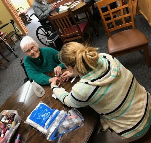 senior woman gets her nails done