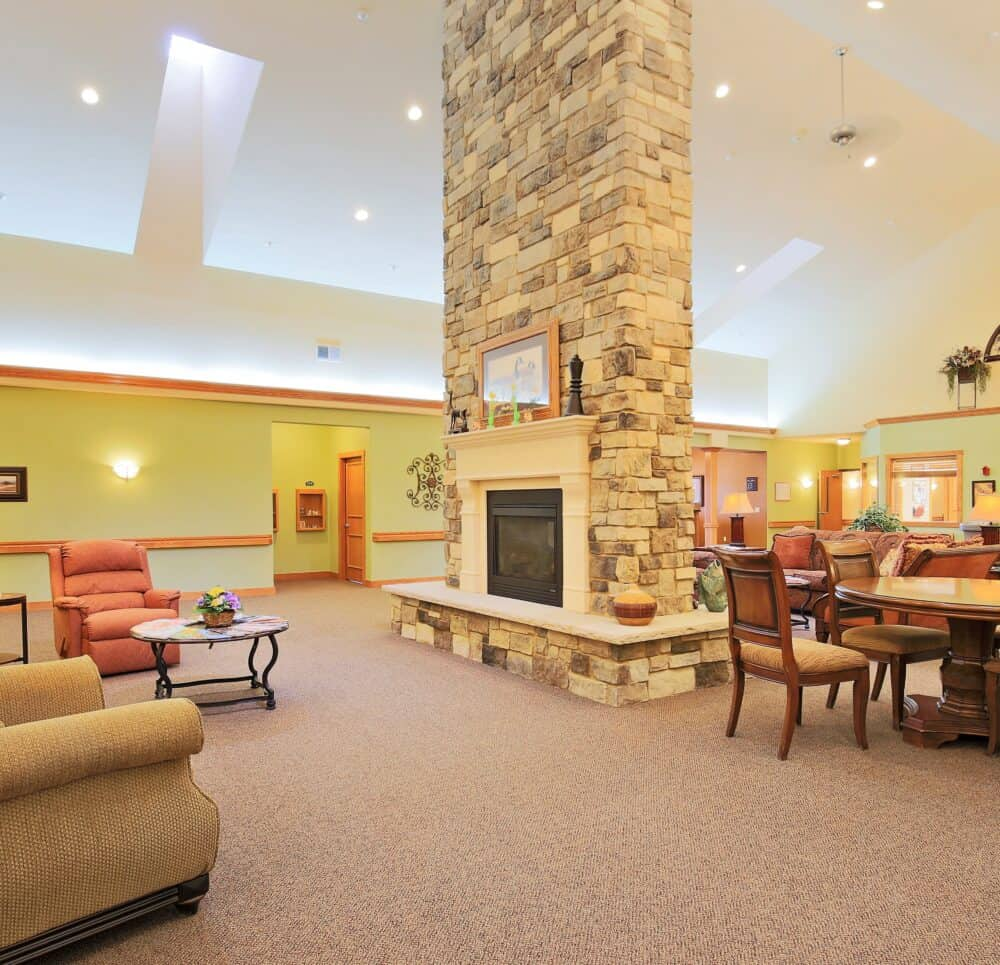 the Waterford at Colby senior living community lobby area with fireplace in Colby, Wisconsin