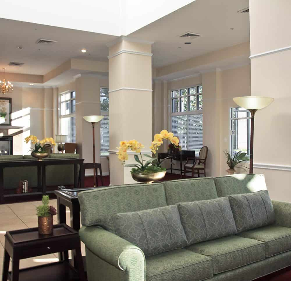 Lobby entrance with seating area at a senior living community located in Springfield, Missouri.
