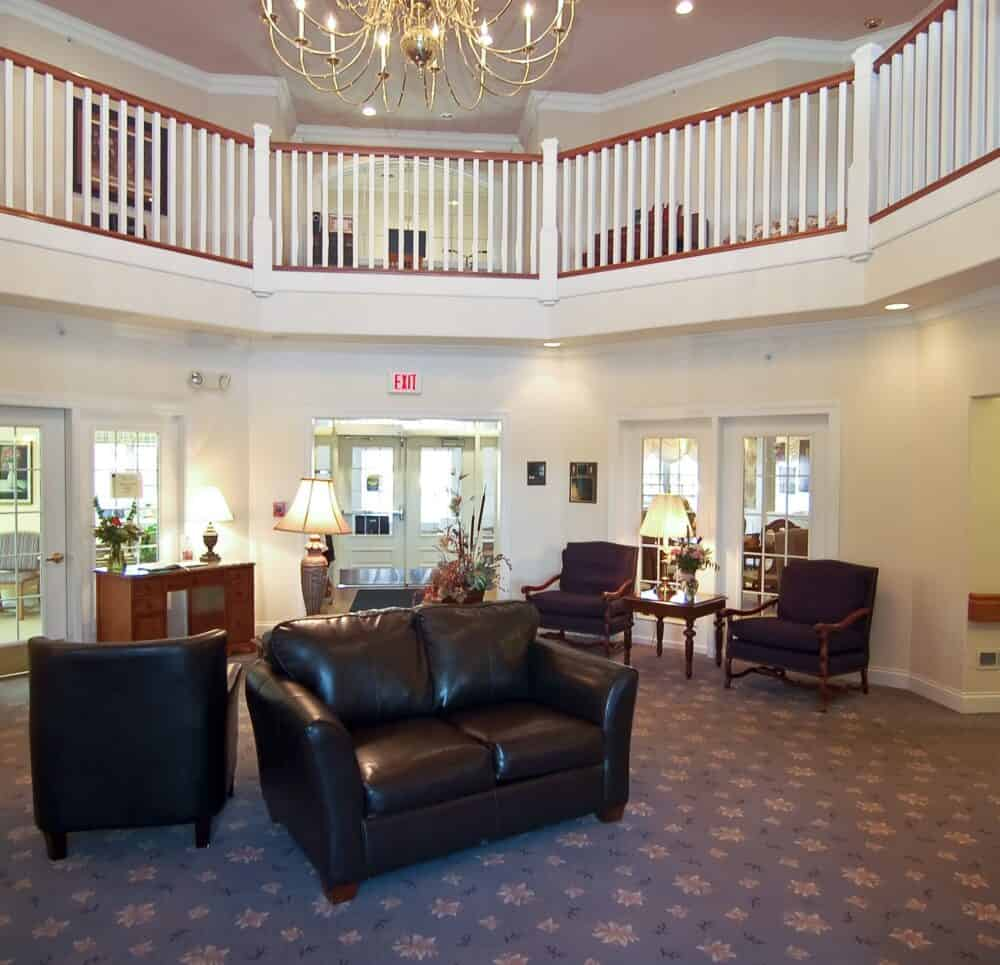 wynnfield crossing, a senior living community in rochester, indiana, has a large lobby and staircase