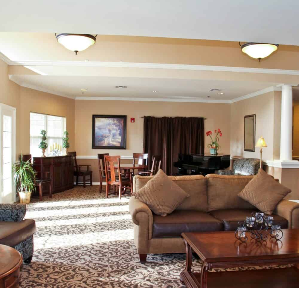 Lounge area with a piano inside Good Tree, a senior living community in Stephenville, Texas.