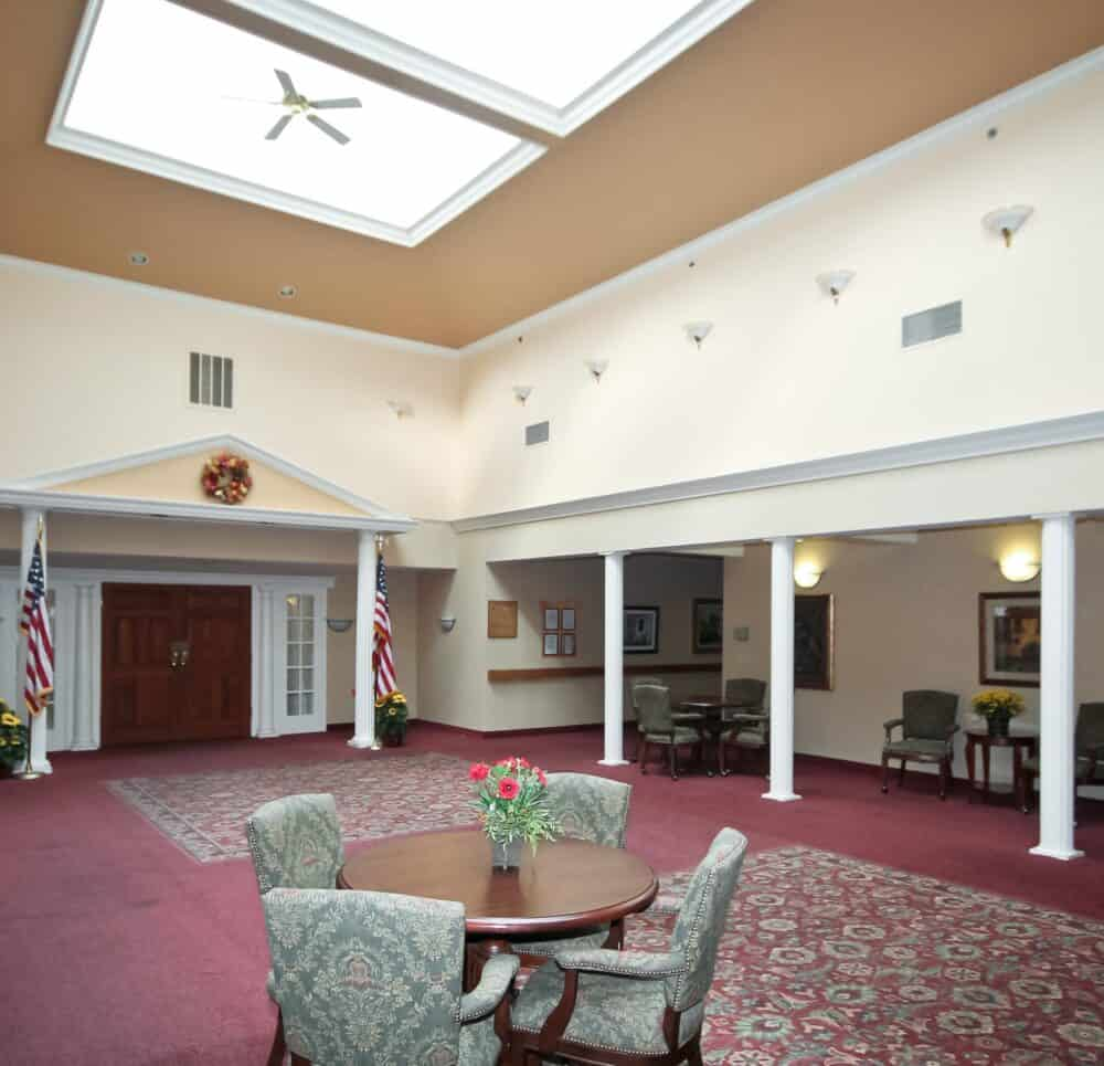 lobby area at the amberleigh, complete with table and chairs and large ceilings