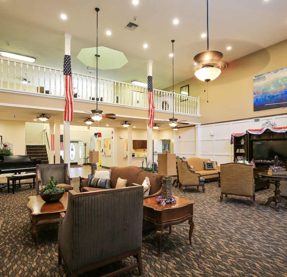 lobby and front entrance at the waterford at carpenter's creek senior living community in pensacola, florida