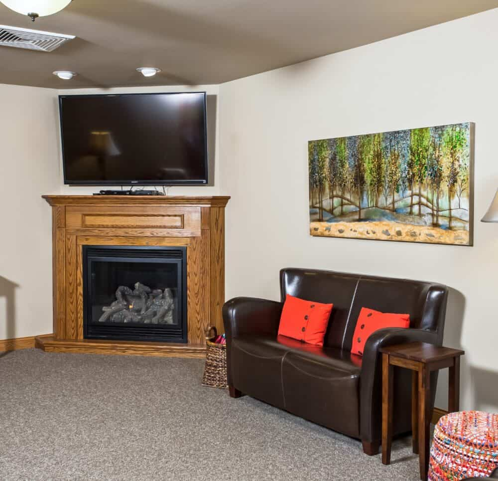 lounge area with TV at the waterford at west bend, a senior living community located in wisconsin