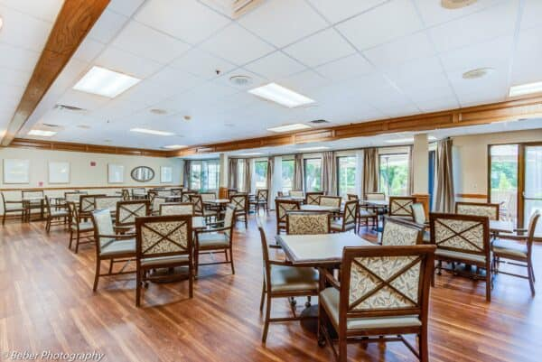 Senior living dining room with comfortable seating and natural light in Hot Springs, Arkansas.