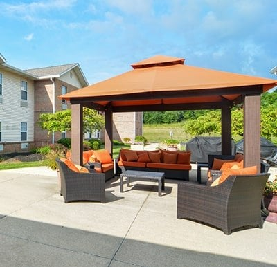 Large gazebo shading outdoor lounge furniture in a courtyard in Mansfield, Ohio.