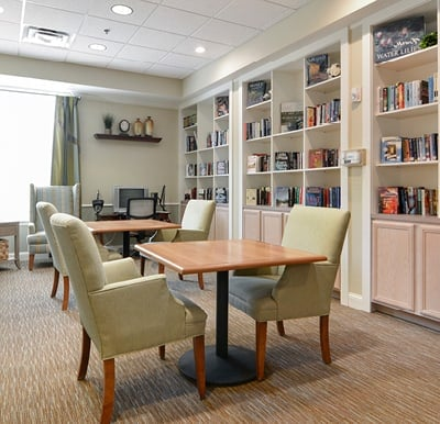 Bright and beautiful library with a wall lined with bookshelves and table seating in Mansfield, Ohio.