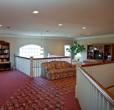 Well-stocked library with books and magazines and comfortable seating.