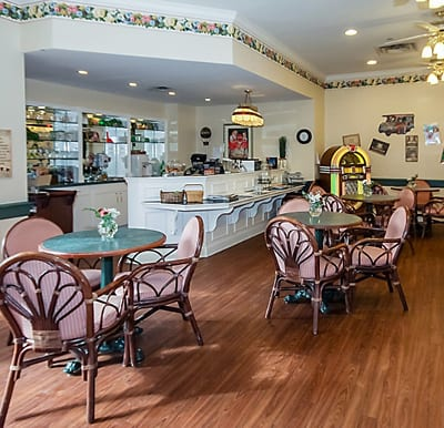 Beautiful ice cream parlor with lots of seating and a jukebox.