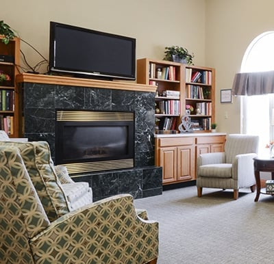 A fireplace with a big-screen TV and bookshelves surrounding in Anderson, Indiana.