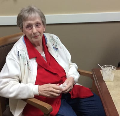 A senior enjoying her cooking class treat in Anderson, Indiana.