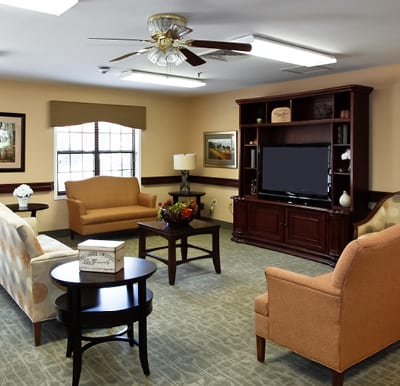 A lounge area with comfortable seating and a big-screen TV.