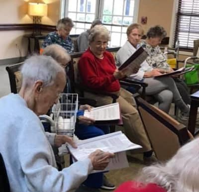 Seniors taking part in a singalong at their independent living/memory care community.