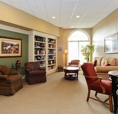 Bright, spacious library with well-stocked bookshelves and comfortable lounge seating in Springfield, Massachusetts.