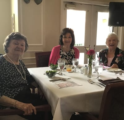 A group of senior women enjoying lunch together at a table in Macedonia, Ohio.