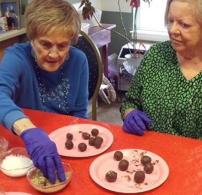 Senior women participating in a baking activity.