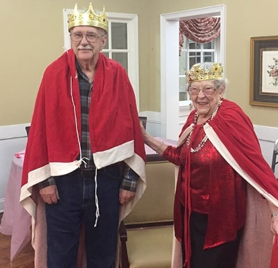 A couple dressed as royalty and celebrating an anniversary.