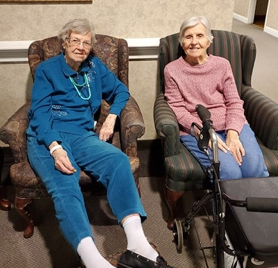 Two friends enjoying conversation in a comfortable lounge area in Columbiana, Ohio.