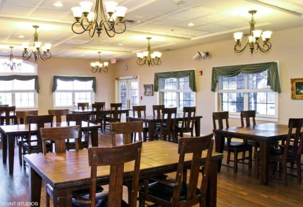 Dining room at a senior living community in Stephenville, Texas with family-style seating.