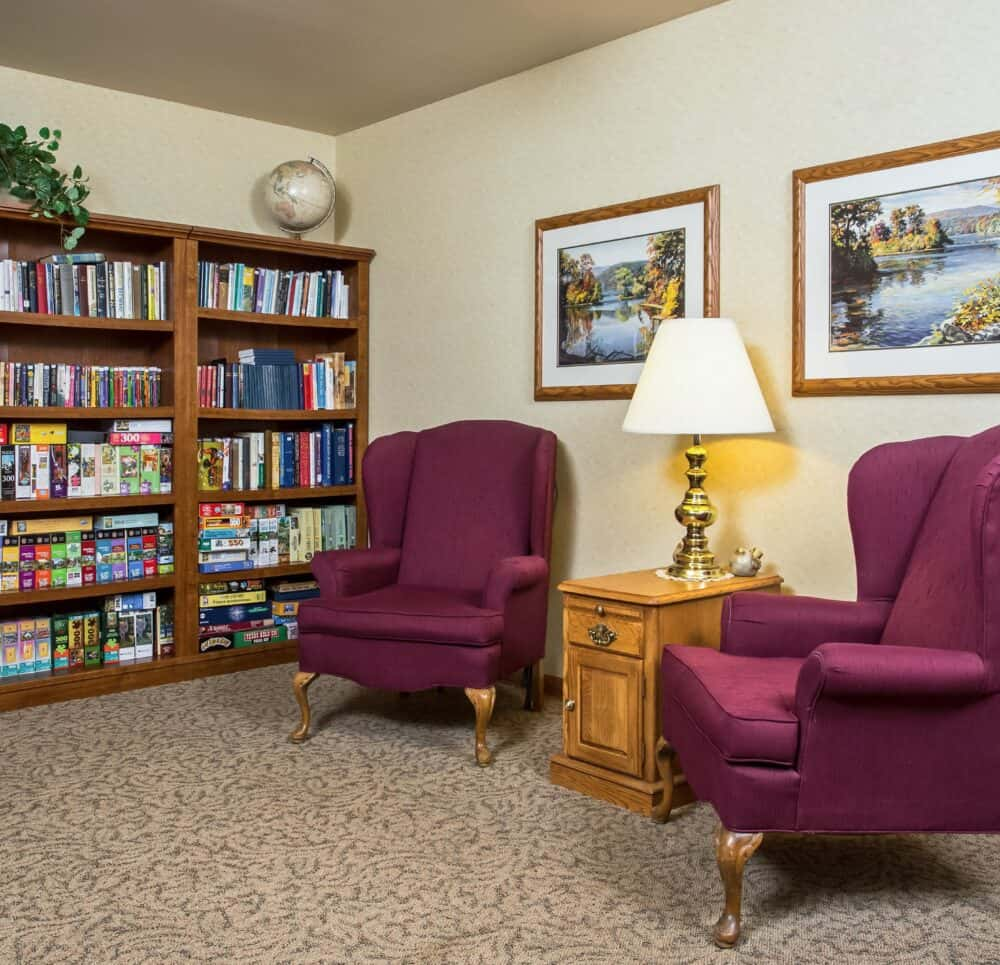 Library with seats at a senior living community located in West Bend, Wisconsin.