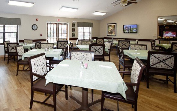 A large dining room with many tables in Anderson, South Carolina.