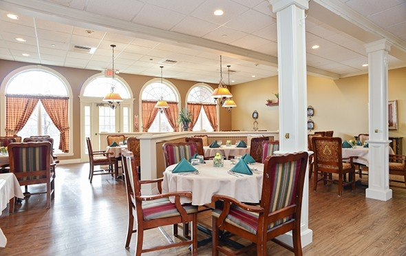 Beautiful, bright dining room with lots of seating and large windows in Springfield, Massachusetts.