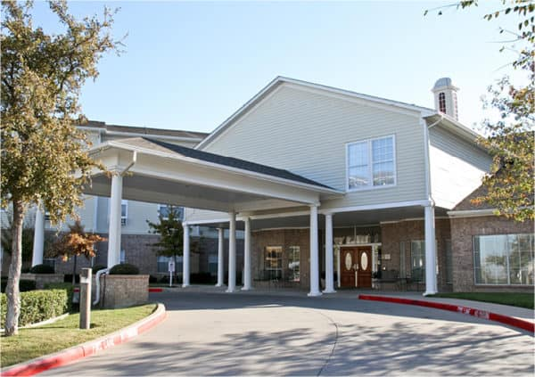 Front entrance of a senior living facility in Fort Worth, Texas.