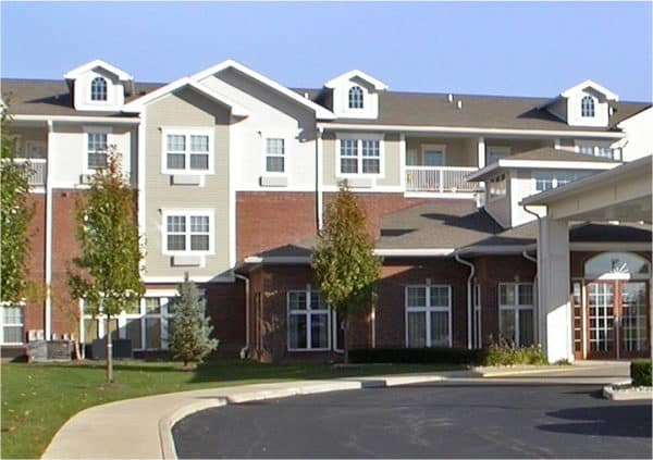 Front entrance of a senior living facility with covered, circular driveway in Perrysburg, Ohio.