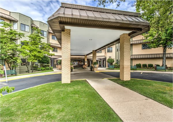 Front entrance of a senior living facility in Hot Springs, Arkansas with covered circular drive.
