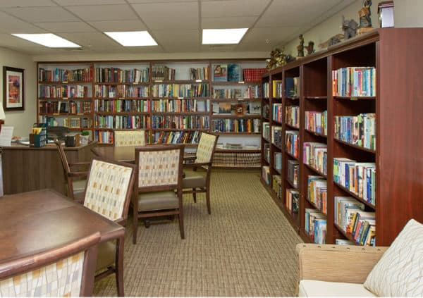 A well-stocked library with many tables and chairs in Cottonwood, Arizona.