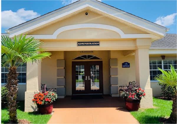 Front entrance of a senior living facility in Pensacola, Florida.