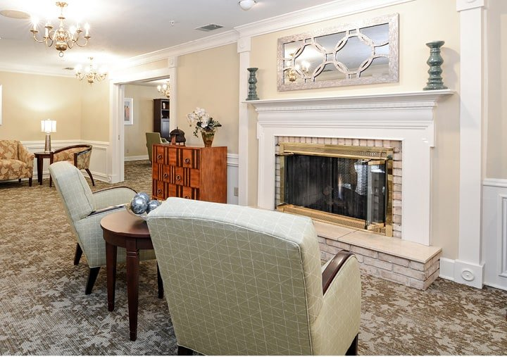 A beautiful lounge area with comfortable seating and a fireplace in Fort Wayne, Indiana.
