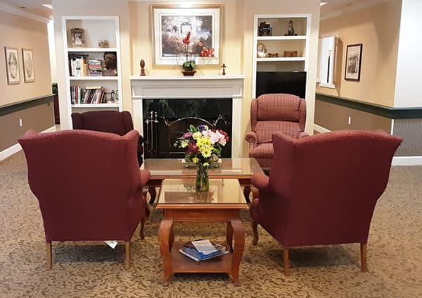 A beautiful lounge area with comfortable seating and a fireplace in Hamilton, Ohio.
