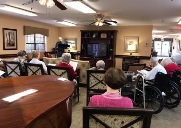 Seniors enjoying a guest speaker at their retirement home in Anderson, South Carolina.