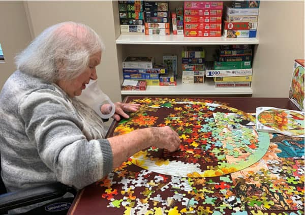 A resident working on a puzzle in the activity center in Humble, Texas.