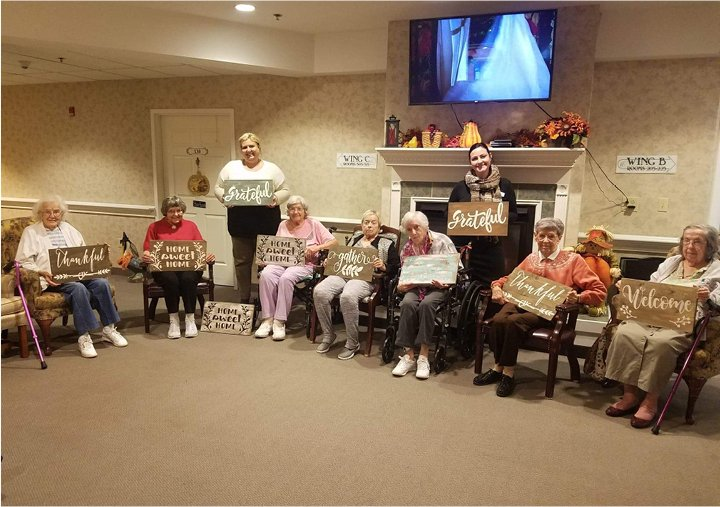 A group of seniors smiling and showing off their completed craft in Columbiana, Ohio.