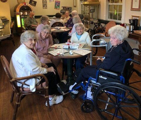 senior ladies playing bingo in the ice cream parlor at the woodlands of hamilton
