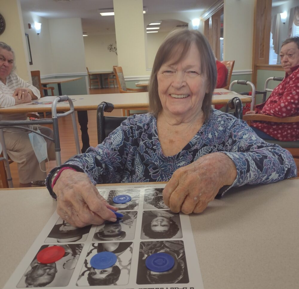 Senior woman plays famous-person Bingo at a senior living community in Jeffersonville, Indiana.