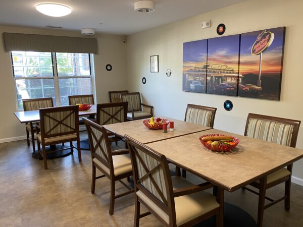 Dining room space with chairs and tables at a senior living community in Fort Wayne, Indiana.