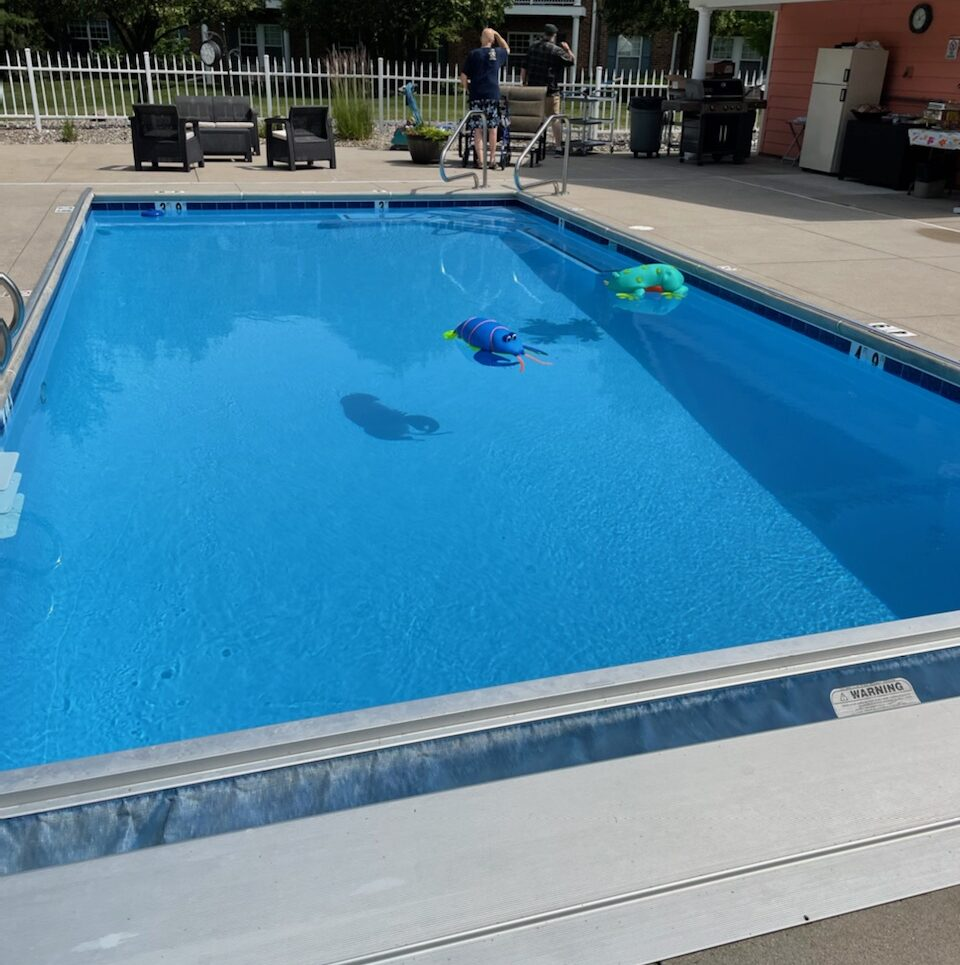 Outdoor, heated pool at Georgetowne Place at a senior living community in Fort Wayne, Indiana.