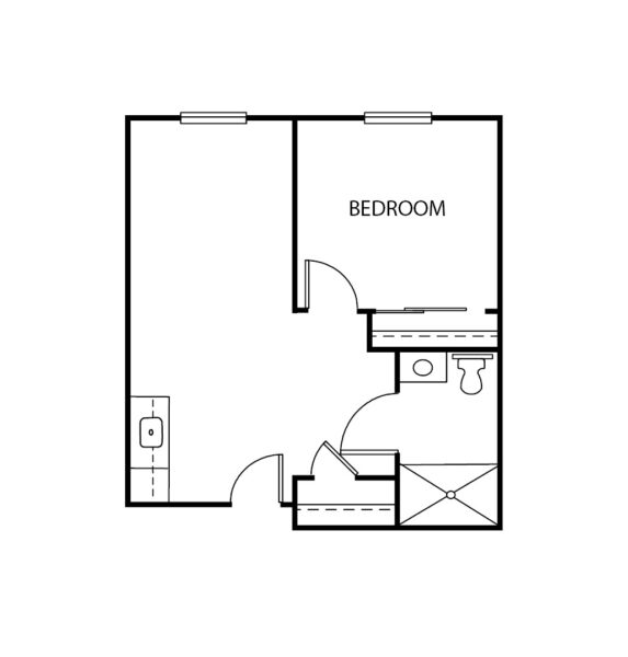 One-bedroom apartment floorplan with living room, bathroom and kitchenette at a senior living facility in Keller, Texas.