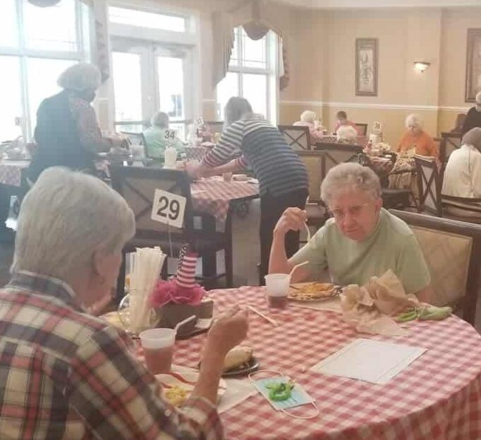 Group of seniors eating a meal together at a senior living facility in Dayton, Ohio.