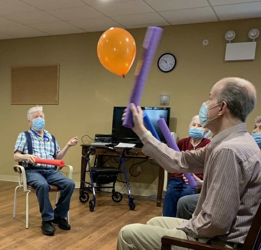 Group of seniors play a game at a senior living community in Oneonta, New York.