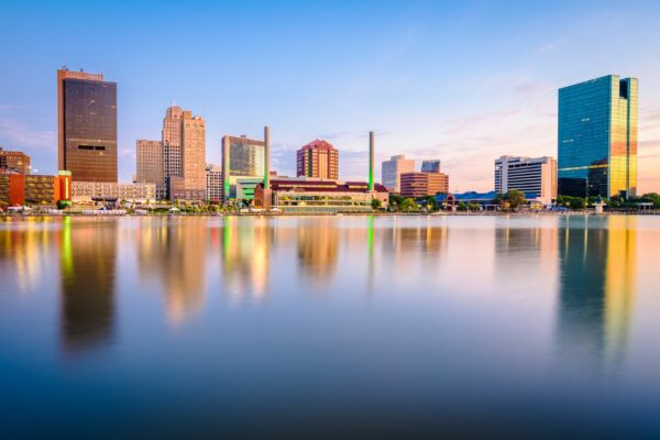 Toledo, Ohio, USA downtown skyline on the Maumee River at dusk