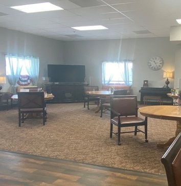 Lounge area with large TV and seating areas at a senior living community in Plattsmouth, Nebraska.